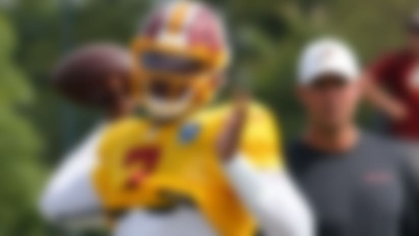 Washington Redskins quarterback Dwayne Haskins Jr. (7) tosses a pass during the Washington Redskins NFL football training camp in Richmond, Va., Monday, Aug. 5, 2019. (AP Photo/Steve Helber)