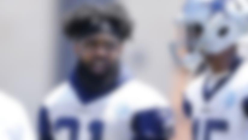 Dallas Cowboys running back Ezekiel Elliott (21) talks with running back Rod Smith (45) and quarterback Dak Prescott (4) during organized team activity at the NFL football team's training facility in Frisco, Texas, Wednesday, May 30, 2018. (James D. Smith via AP)