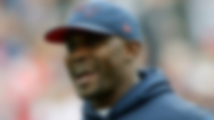 FILE - In this Sept. 9, 2018, file photo, New England Patriots linebackers coach Brian Flores watches his team warm up before an NFL football game against the Houston Texans in Foxborough, Mass. With only a handful of minorities in the stepping-stone positions of offensive coordinator and quarterbacks coach, the NFL saw its sharpest-ever one-year drop in minority head coaches, causing concern among advocates for diversity declaring unsatisfactory progress 16 years after the Rooney Rule was implemented. (AP Photo/Charles Krupa, File)