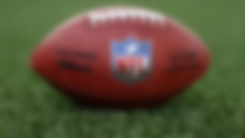 A detail view of a football is seen on the field Tuesday, May 5, 2020, in Houston. (Aaron M. Sprecher via AP)