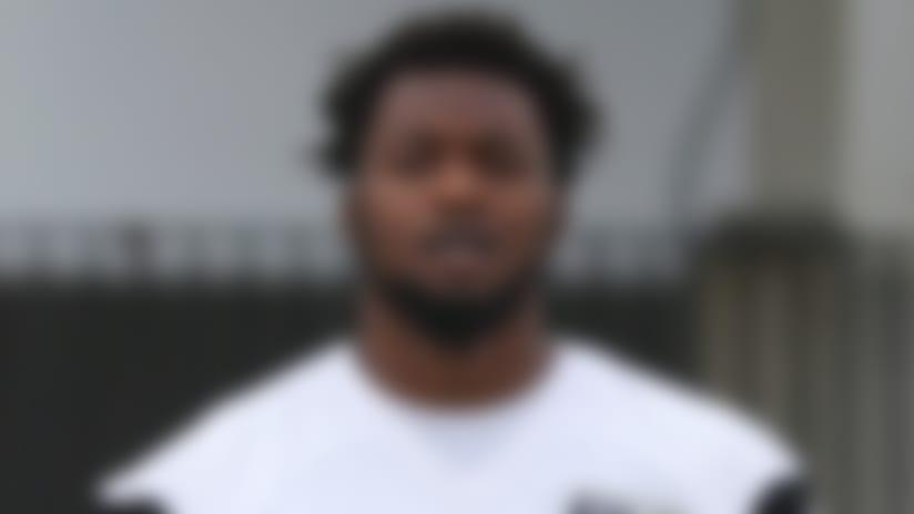 Jacksonville Jaguars defensive tackle Taven Bryan (90) and defensive end Dante Fowler (56) walk out for mandatory mini camp, Tuesday, June 12, 2018 in Jacksonville, Fla. (Logan Bowles via AP)