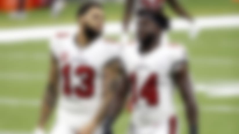 Tampa Bay Buccaneers wide receivers Mike Evans (13) and Chris Godwin (14) after an NFL football game against the New Orleans Saints, Sunday, Sept. 13, 2020, in New Orleans. (AP Photo/Tyler Kaufman)