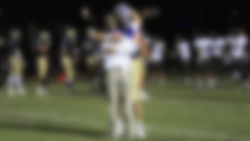 After a win in the same week his grandfather died, CHS coach Joey King received a hug from Lawrence at midfield. (@Trevorlawrencee/Twitter)