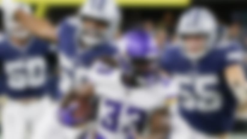 Minnesota Vikings running back Dalvin Cook (33) runs the ball as Dallas Cowboys' Robert Quinn (58) and Leighton Vander Esch (55) give chase during the first half of an NFL football game in Arlington, Texas, Sunday, Nov. 10, 2019. (AP Photo/Michael Ainsworth)