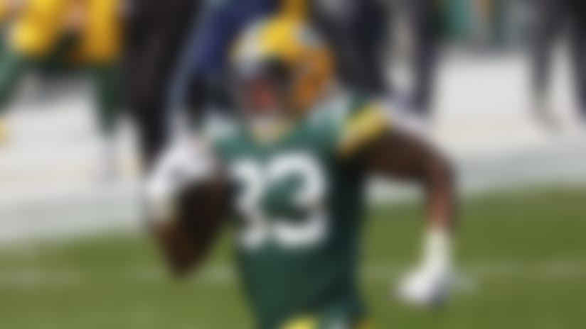 Green Bay Packers' Aaron Jones(33) runs for a touchdown during an NFL football game between the Detroit Lions and Green Bay Packers, Sunday, Sept. 20, 2020, in Green Bay, Wis. (AP Photo/Jeffrey Phelps)