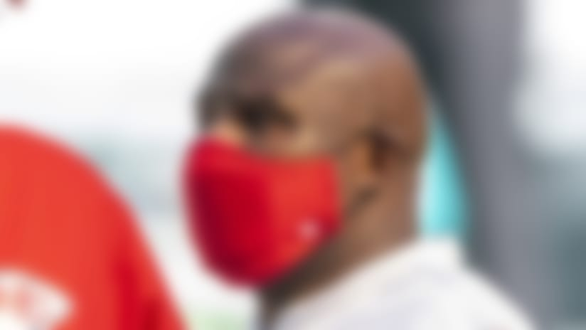 From left, Kansas City Chiefs head coach Andy Reid and Kansas City Chiefs offensive coordinator Eric Bieniemy wear masks as they talk on the field before the Chiefs take on the Miami Dolphins during an NFL football game, Sunday, Dec. 13, 2020, in Miami Gardens, Fla. (AP Photo/Doug Murray)