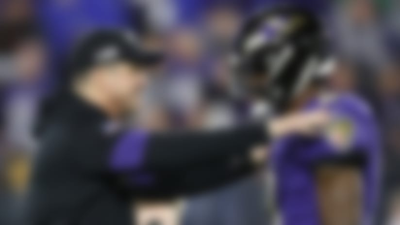 Baltimore Ravens head coach John Harbaugh, left, talks with quarterback Lamar Jackson (8) prior to an NFL divisional playoff football game against the Tennessee Titans, Saturday, Jan. 11, 2020, in Baltimore. The Titans won 28-12. (AP Photo/Julio Cortez)