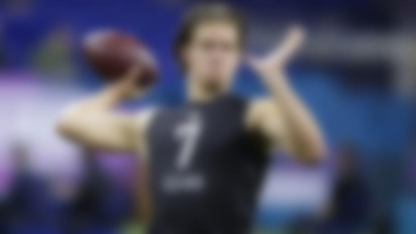 Oregon quarterback Justin Herbert runs a drill at the NFL football scouting combine in Indianapolis, Thursday, Feb. 27, 2020. (AP Photo/Michael Conroy)