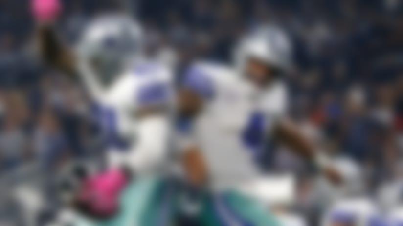 Dallas Cowboys running back Ezekiel Elliott (21) celebrates a touchdown with teammate Dak Prescott (4) in the second half of an NFL football game against the Jacksonville Jaguars in Arlington, Texas, Sunday, Oct. 14, 2018. (AP Photo/Ron Jenkins)