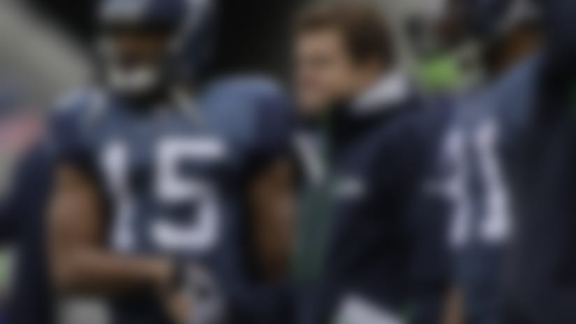 """Seahawks receiver Doug Baldwin, shown shaking hands with Schneider before a 2011 game, credits Schneider as a """"very open, very vulnerable"""" GM who """"really wants you to understand where he's coming from."""""""