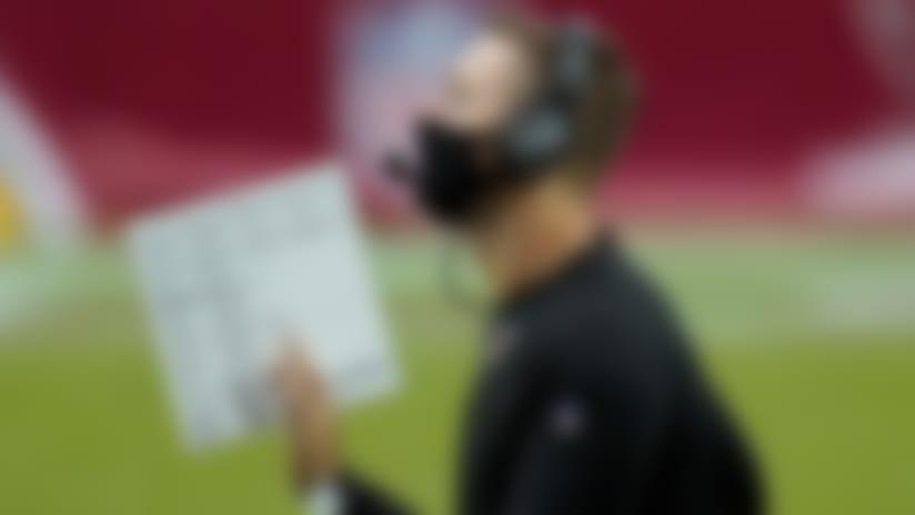 Arizona Cardinals head coach Kliff Kingsbury makes a call during the second half of an NFL football game against the Washington Football Team, Sunday, Sept. 20, 2020, in Glendale, Ariz. (AP Photo/Ross D. Franklin)