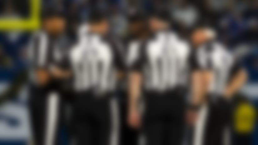 Referees in a group huddle during an NFL regular season football game against the Carolina Panthers and the Indianapolis Colts on Saturday, Dec. 21, 2019 in Indianapolis. The Colts won, 38-6. (Ric Tapia via AP)