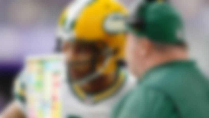 Green Bay Packers head coach Mike McCarthy talks with quarterback Brett Hundley (7) on the sidelines during an NFL football game against the Minnesota Vikings, Sunday, Oct. 15, 2017, in Minneapolis. The Vikings won 23-10. (Scott Boehm via AP)