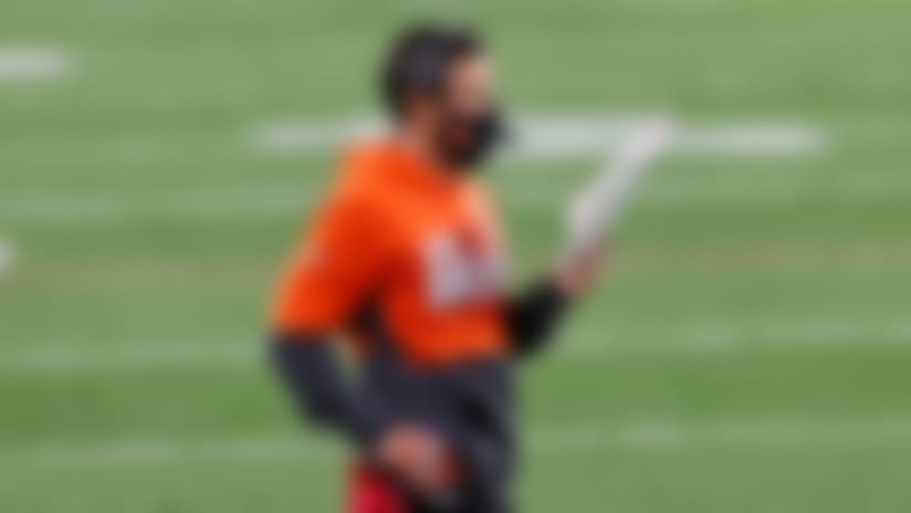 Cleveland Browns coach Kevin Stefanski looks at chart during the first half of the team's NFL football game against the Cincinnati Bengals, Thursday, Sept. 17, 2020, in Cleveland. (AP Photo/Ron Schwane)