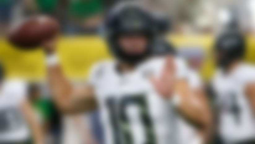Oregon quarterback Justin Herbert (10) throws before playing Auburn in an NCAA college football game, Saturday, Aug. 31, 2019, in Arlington, Texas. (AP Photo/Ron Jenkins)