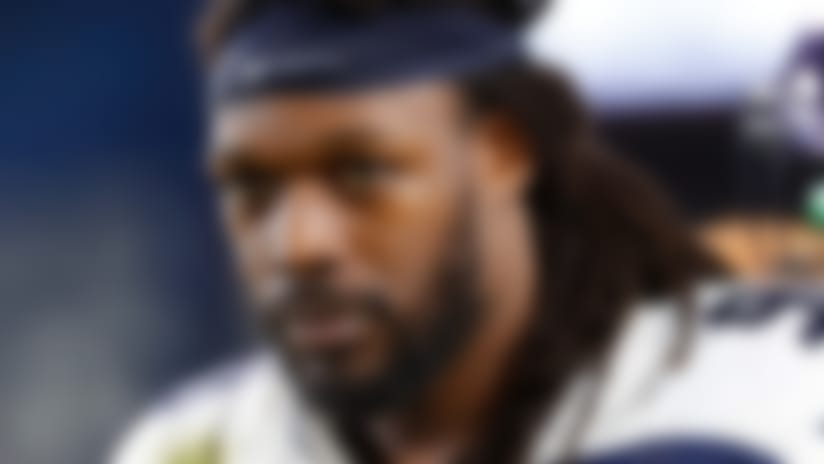 Seattle Seahawks defensive end Jadeveon Clowney (90) watches from the sideline during an NFL game against the Los Angeles Rams, Sunday, Dec. 8, 2019, in Los Angeles. The Rams defeated the Seahawks 28-12. (Kevin Terrell via AP)