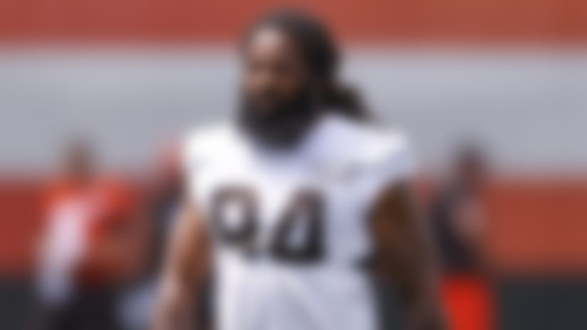Cleveland Browns defensive end Adrian Clayborn walks onto the field during practice at the NFL football team's training facility Friday, Aug. 14, 2020, in Berea, Ohio. (AP Photo/Ron Schwane)