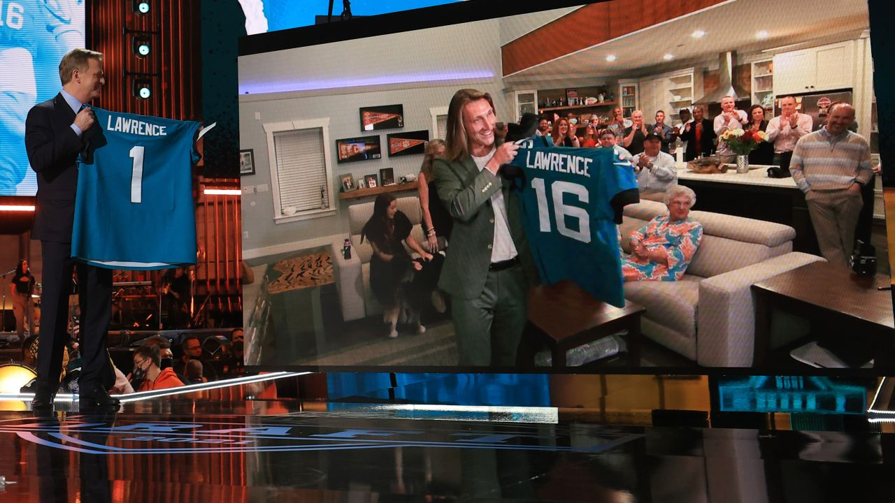 NFL Commissioner Roger Goodell holds a Jacksonville Jaguars jersey as he announces that the Jaguars had chosen Clemson quarterback Trevor Lawrence with the first pickduring the 2021 NFL Draft on Thursday, April 29, 2021 in Cleveland, Ohio.