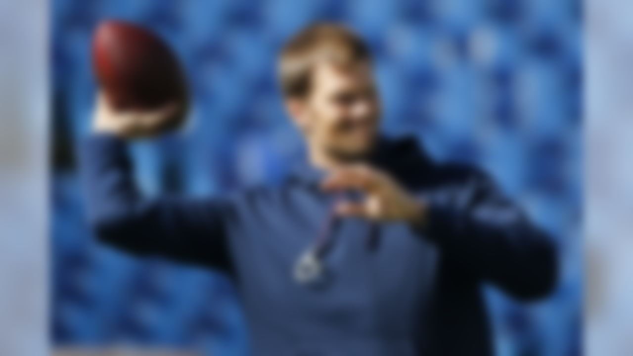 New England Patriots quarterback Tom Brady warms up before an NFL football game against the Buffalo Bills, Sunday, Oct. 12, 2014, in Orchard Park, N.Y. (AP Photo/Mike Groll)