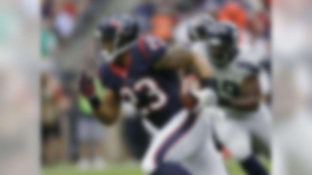 Houston Texans' Arian Foster (23) runs against the Seattle Seahawks during the first quarter an NFL football game Sunday, Sept. 29, 2013, in Houston. (AP Photo/David J. Phillip)