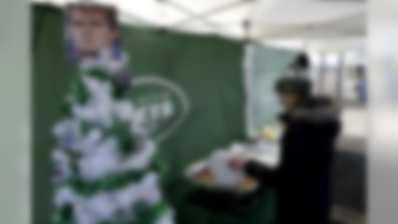 A photograph of New York Jets quarterback Sam Darnold tops a Christmas tree at a tailgate party prior to an NFL football game between the Green Bay Packers and the Jets, Sunday, Dec. 23, 2018, in East Rutherford, N.J. (AP Photo/Julio Cortez)