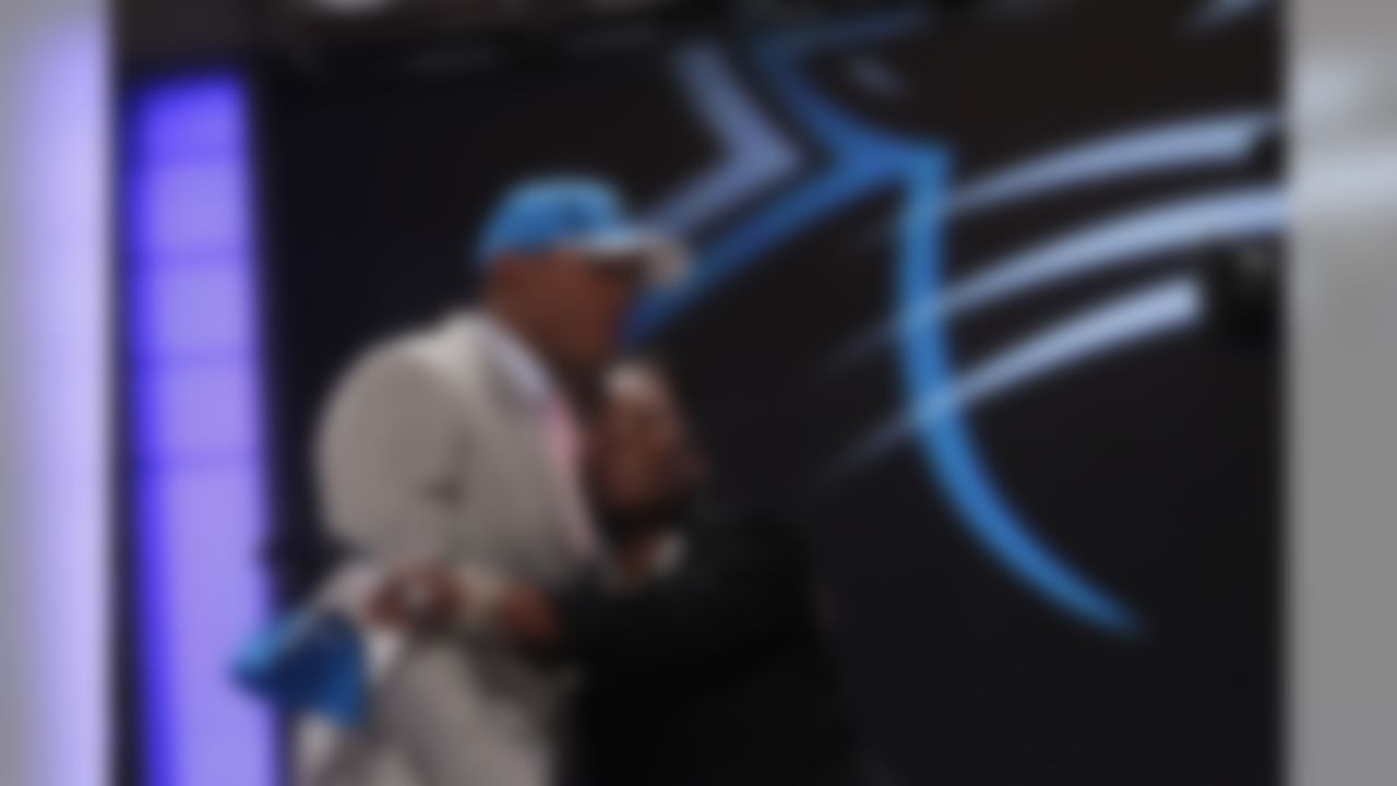 Auburn Quarterback Cam Newton  hugs a loved one after he was selected as the first pick overall by the Carolina Panthers in the first round of the NFL football draft at Radio City Music Hall Thursday, April 28, 2011, in New York. (AP Photo/Jason DeCrow)