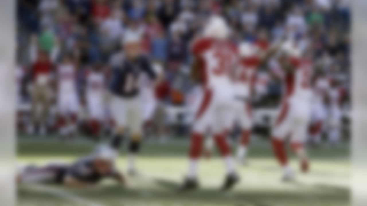 New England Patriots kicker Stephen Gostkowski (3) lies on the field alongside Arizona Cardinals cornerback Justin Bethel (31) after missing a field at the end of the fourth quarter of an NFL football game on Sunday, Sept. 16, 2012, in Foxborough, Mass. Patriot's Zoltan Mesko (14), the holder on the play, reacts. The Cardinals won 20-18. (AP Photo/Elise Amendola)
