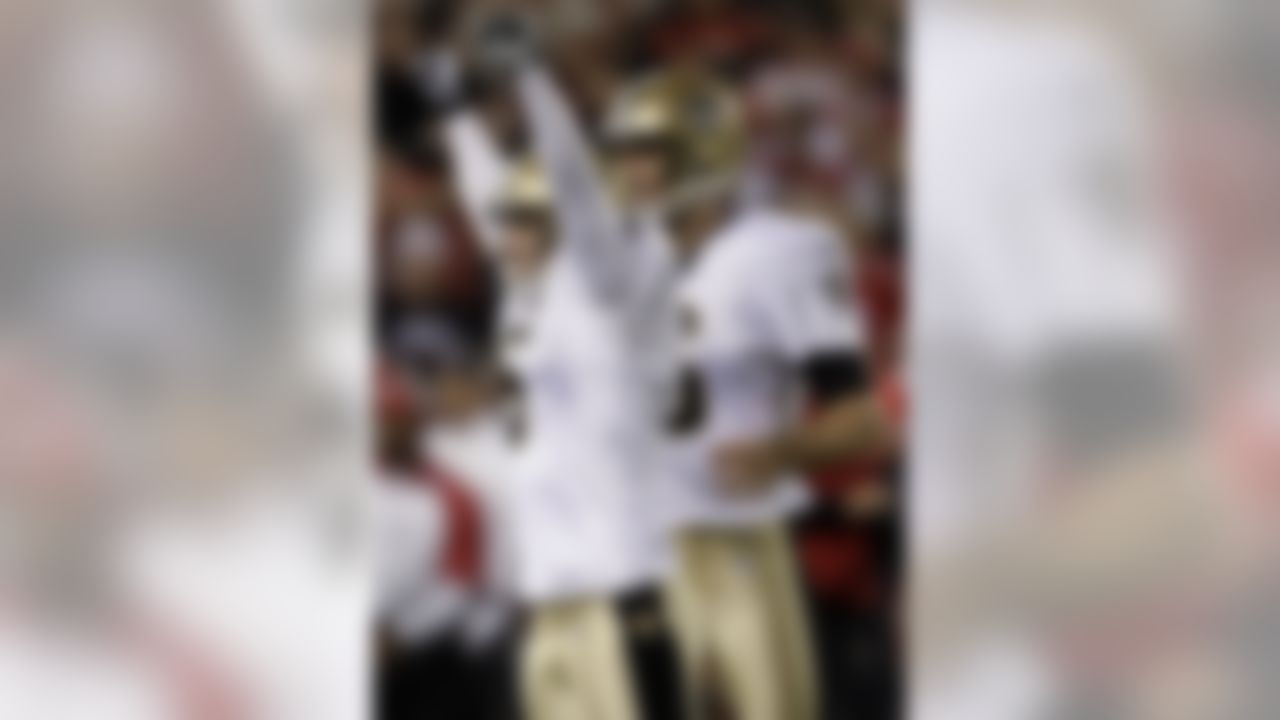 New Orleans Saints' Garrett Hartley celebrates after kicking a 37-yard field goal as time expired to give the Saints a 25-22 win over the San Francisco 49ers in an NFL football game in San Francisco, Monday, Sept. 20, 2010. (AP Photo/Marcio Jose Sanchez)
