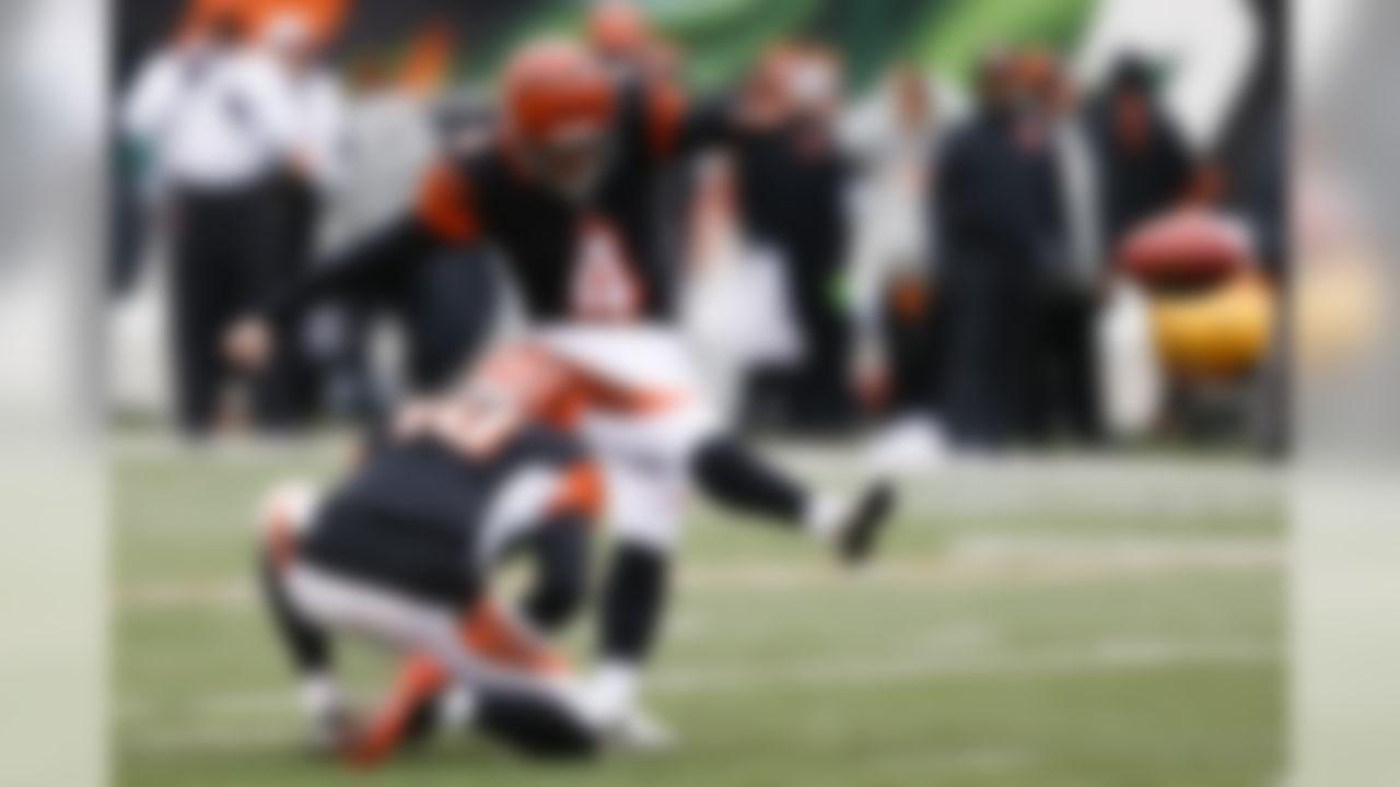 Cincinnati Bengals kicker Randy Bullock (4) boots a field goal alongside punter Kevin Huber (10) in the first half of an NFL football game against the Pittsburgh Steelers, Sunday, Dec. 18, 2016, in Cincinnati. (AP Photo/Gary Landers)