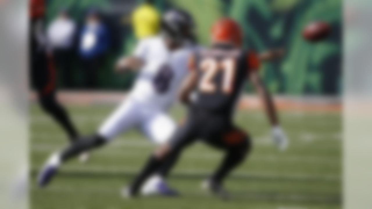 Baltimore Ravens quarterback Lamar Jackson (8) tosses the ball against Cincinnati Bengals defensive back Darqueze Dennard (21) during the first half of NFL football game, Sunday, Nov. 10, 2019, in Cincinnati. (AP Photo/Gary Landers)