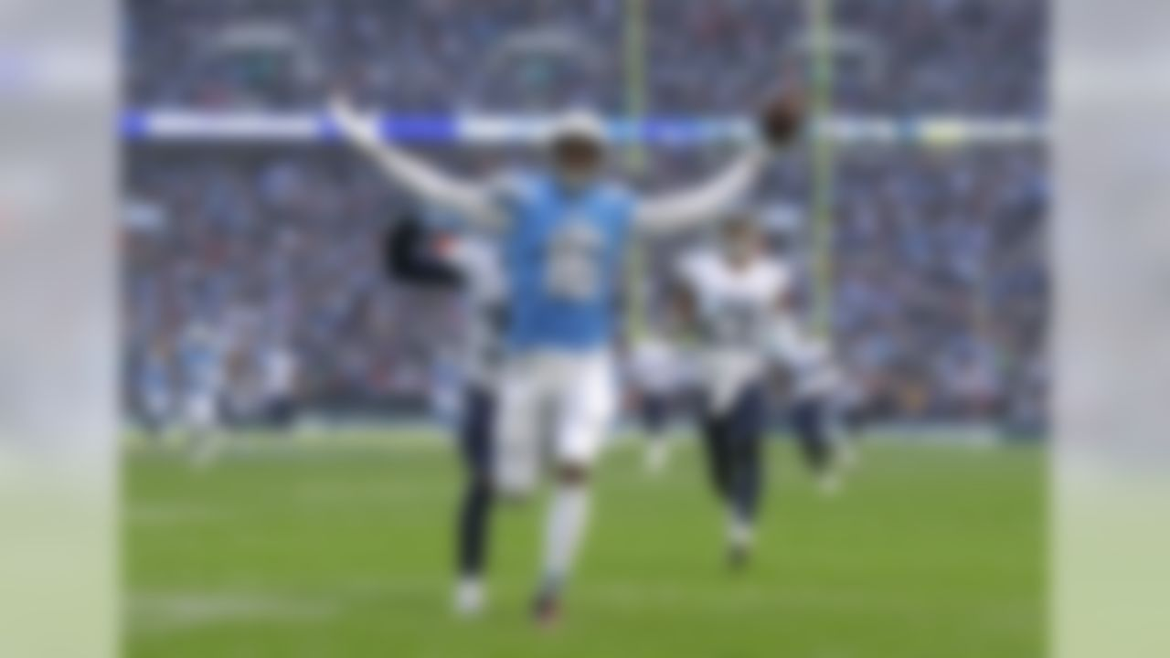 Los Angeles Chargers wide receiver Tyrell Williams (16) celebrates as he scores a touchdown during the first half of an NFL football game against Tennessee Titans at Wembley stadium in London, Sunday, Oct. 21, 2018. (AP Photo/Matt Dunham)