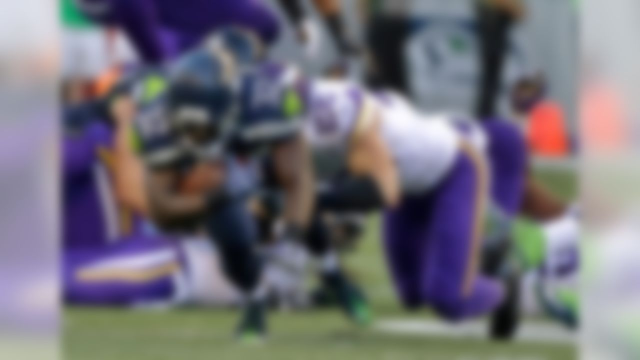 Seattle Seahawks running back Christine Michael (32) is tackled by Minnesota Vikings free safety Harrison Smith (22) during the first half of a preseason NFL football game Thursday, Aug. 18, 2016, in Seattle. (AP Photo/Elaine Thompson)