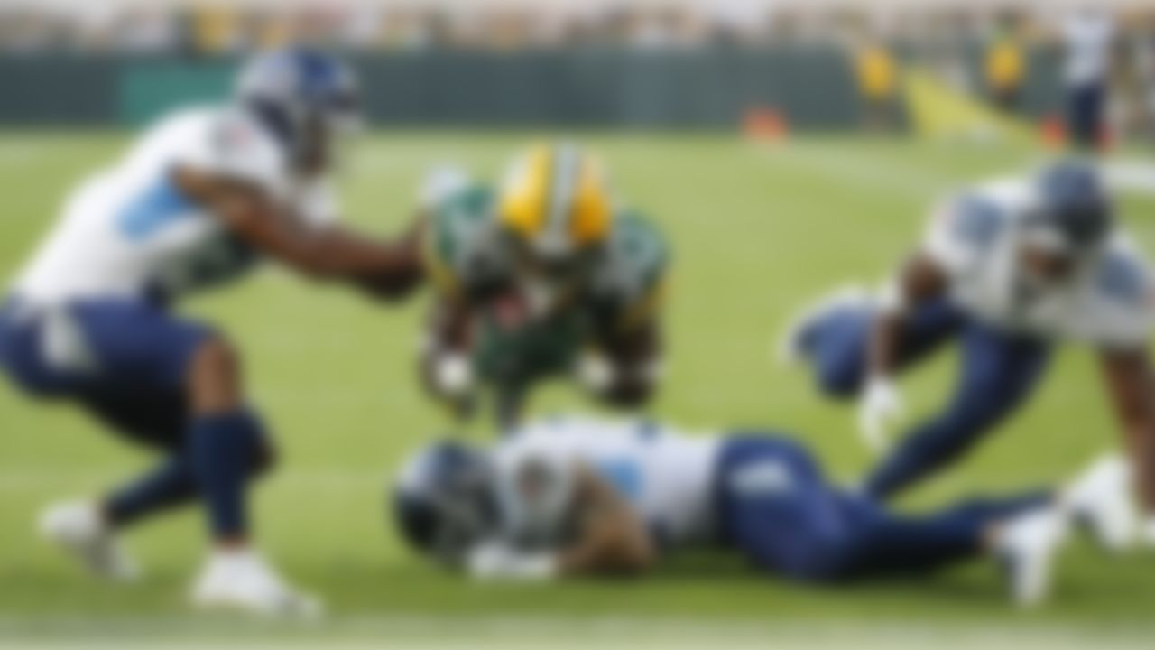 Green Bay Packers' Jamaal Williams dives into the end zone for a touchdown during the first half of a preseason NFL football game against the Tennessee Titans Thursday, Aug. 9, 2018, in Green Bay, Wis. (AP Photo/Matt Ludtke)