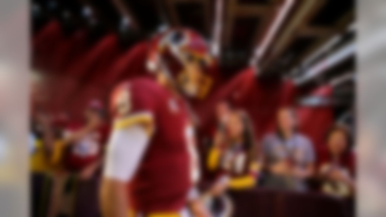 Washington Redskins quarterback Kirk Cousins walks out of a tunnel to the field before an NFL football game against the Philadelphia Eagles, Sunday, Sept. 10, 2017, in Landover, Md.