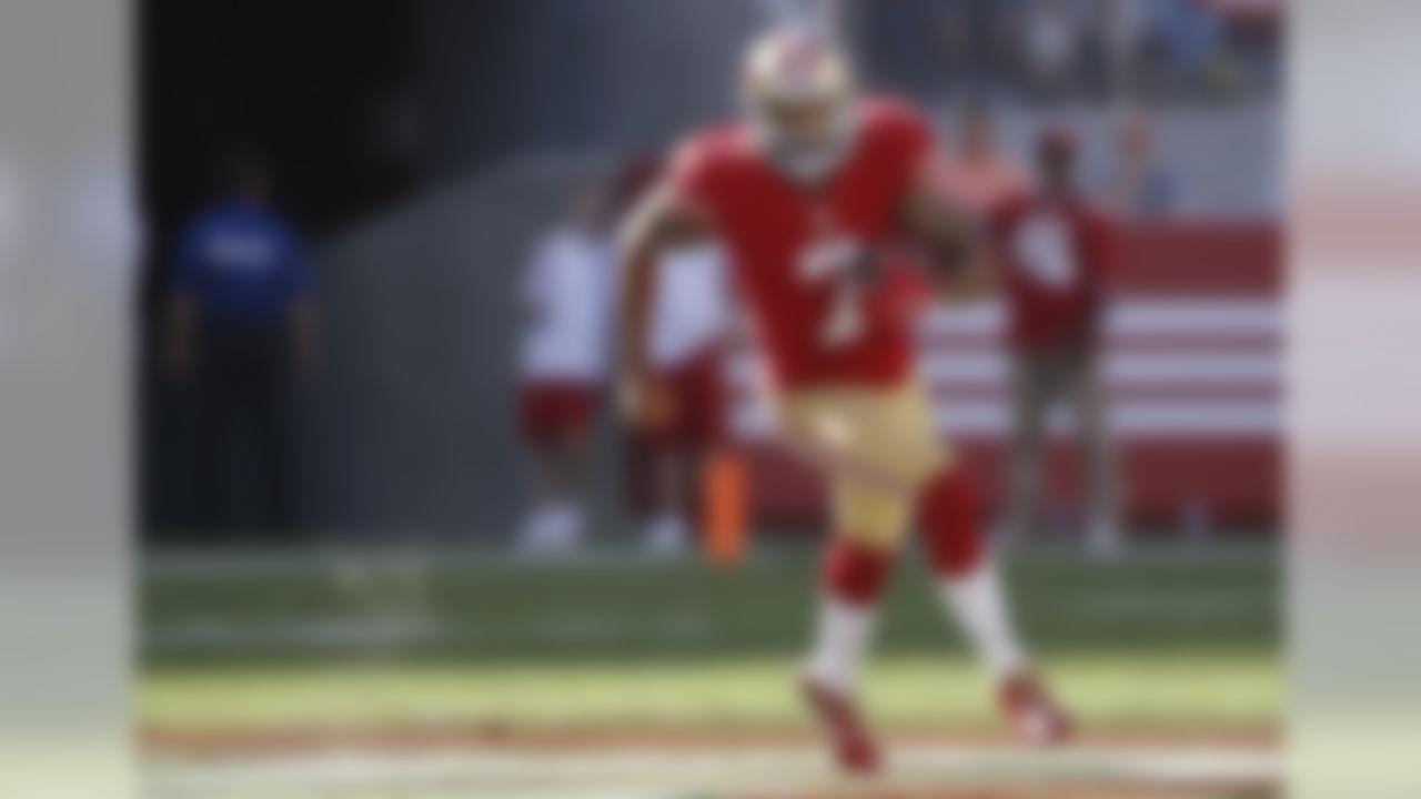San Francisco 49ers quarterback Colin Kaepernick (7) runs against the Dallas Cowboys during the first half of an NFL preseason football game in Santa Clara, Calif., Sunday, Aug. 23, 2015. (AP Photo/Tony Avelar)