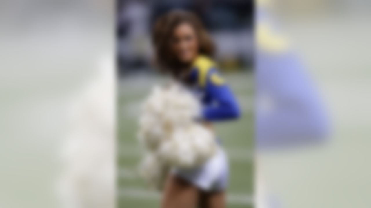 A St. Louis Rams cheerleader performs during the fourth quarter of an NFL football game Sunday, Oct. 30, 2011, in St. Louis. (AP Photo/Tom Gannam)