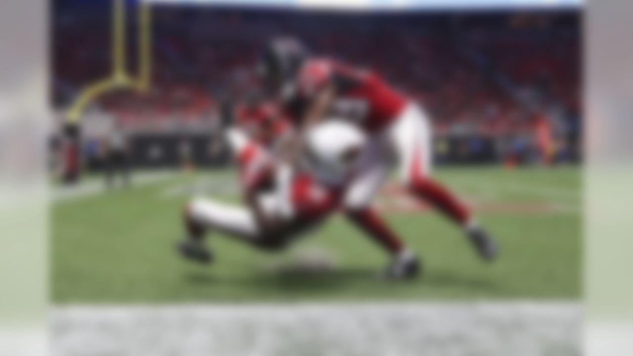 Arizona Cardinals wide receiver John Brown (12) scores a touchdown Atlanta Falcons cornerback C.J. Goodwin (29) defends during a NFL preseason game, Saturday, Aug. 26, 2017 in Atlanta. (Logan Bowles / NFL)