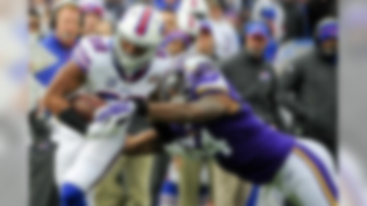 Minnesota Vikings middle linebacker Jasper Brinkley (54) strips the ball from Buffalo Bills' Fred Jackson (22) during the first half of an NFL football game Sunday, Oct. 19, 2014, in Orchard Park, N.Y. (AP Photo/Gary Wiepert)