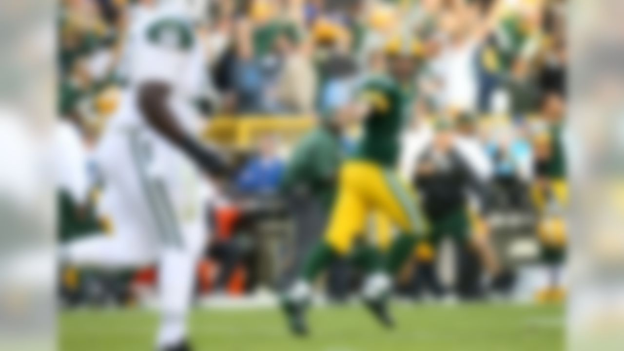 Green Bay Packers quarterback Aaron Rodgers (12) reacts to throwing a touchdown pass against the New York Jets in the third quarter on Sunday, Sept. 14, 2014, in Green Bay, Wis. (Todd Rosenberg/NFL)