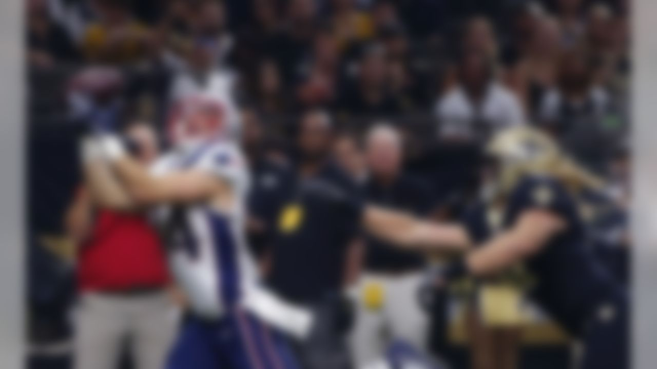 New England Patriots running back Rex Burkhead (34) pulls in a touchdown recetion in front of New Orleans Saints linebacker Alex Anzalone (47) in the first half of an NFL football game in New Orleans, Sunday, Sept. 17, 2017. (AP Photo/Butch Dill)