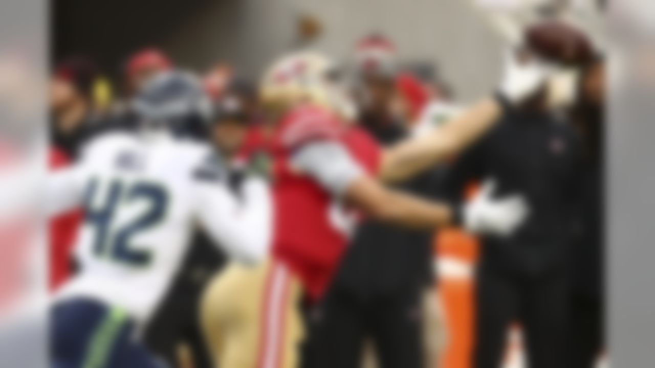 San Francisco 49ers tight end George Kittle, right, cannot catch a pass in front of Seattle Seahawks defensive back Delano Hill (42) during the first half of an NFL football game in Santa Clara, Calif., Sunday, Dec. 16, 2018. (AP Photo/Ben Margot)