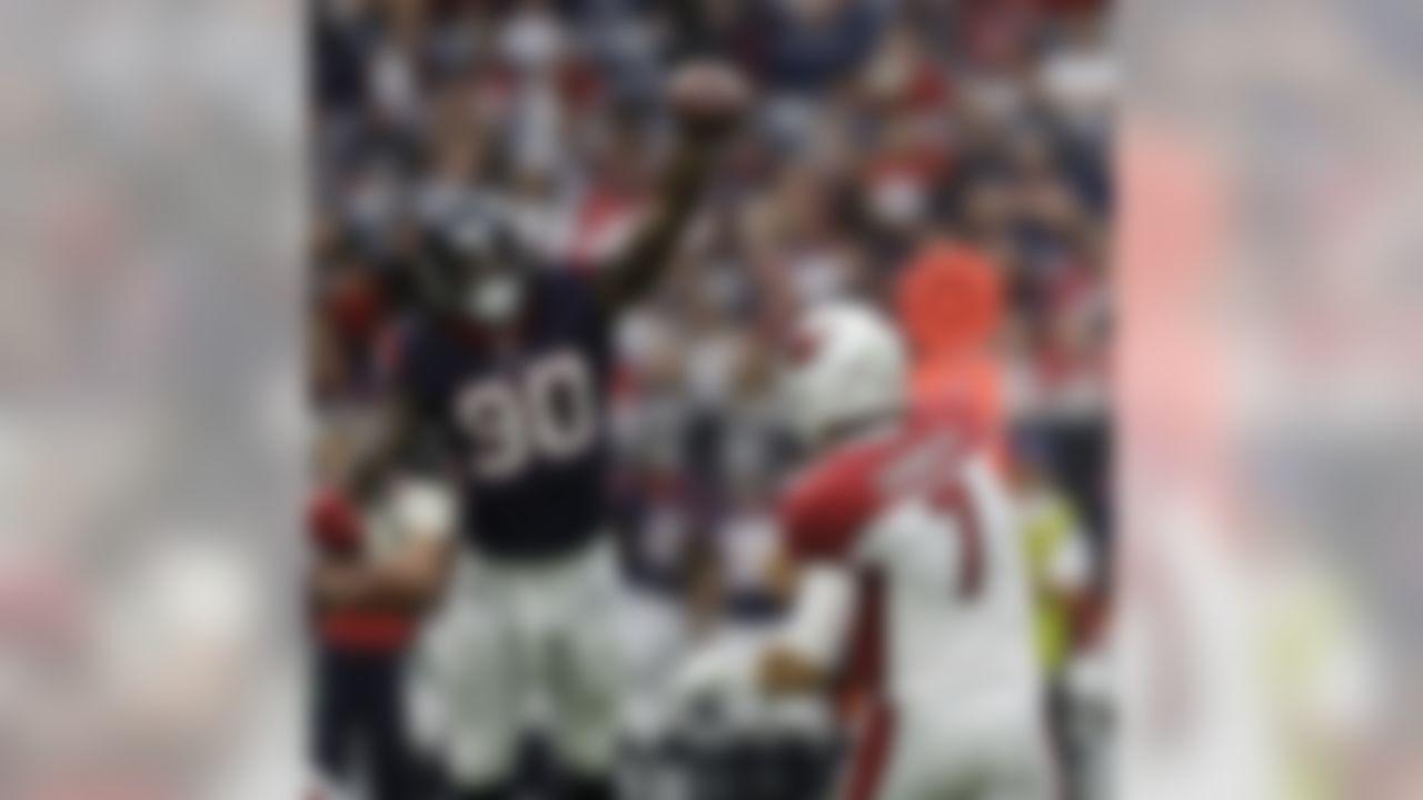 Arizona Cardinals quarterback Blaine Gabbert (7) has his pass blocked by Houston Texans outside linebacker Jadeveon Clowney (90) during the first half of an NFL football game, Sunday, Nov. 19, 2017, in Houston. (AP Photo/David J. Phillip)