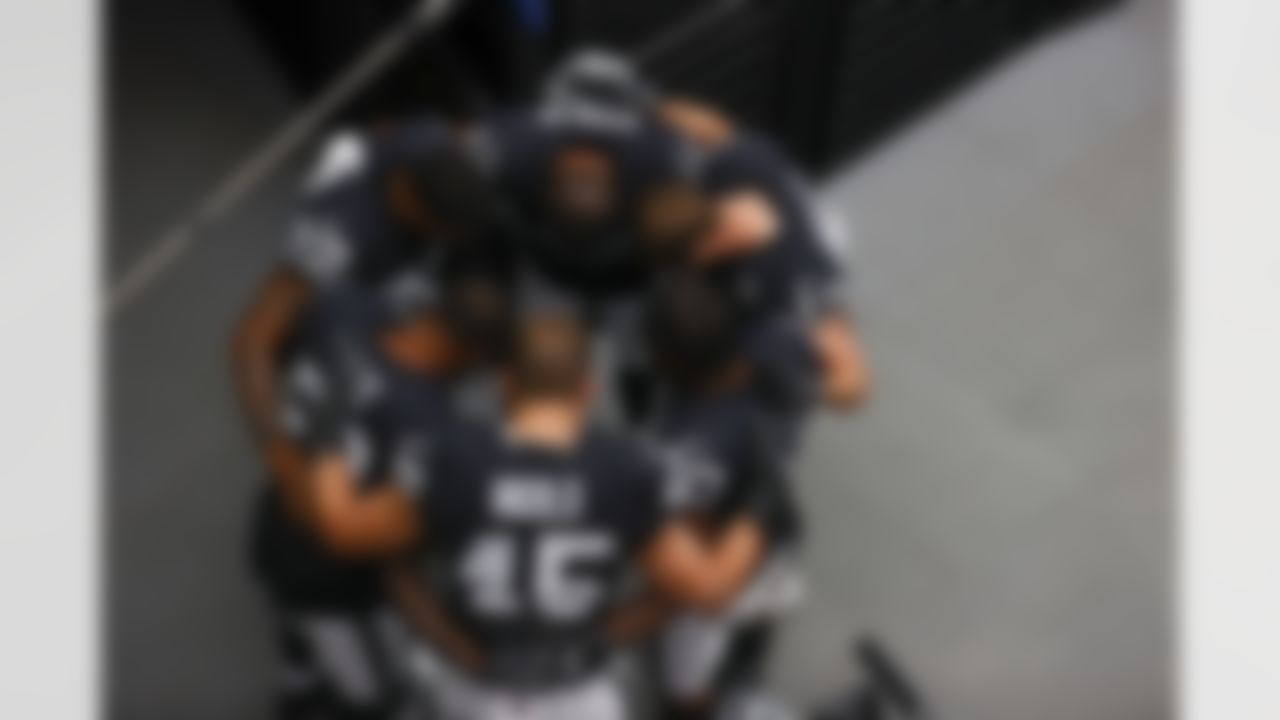 Las Vegas Raiders players huddle up before an NFL football game against the Buffalo Bills on Sunday, October 4, 2020 in Las Vegas, Nevada.