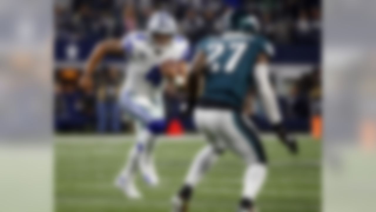 Dallas Cowboys' Dak Prescott (4) keeps the ball as Philadelphia Eagles' Malcolm Jenkins (27) pursues in the first half of an NFL football game, Sunday, Nov. 19, 2017, in Arlington, Texas. (AP Photo/Ron Jenkins)
