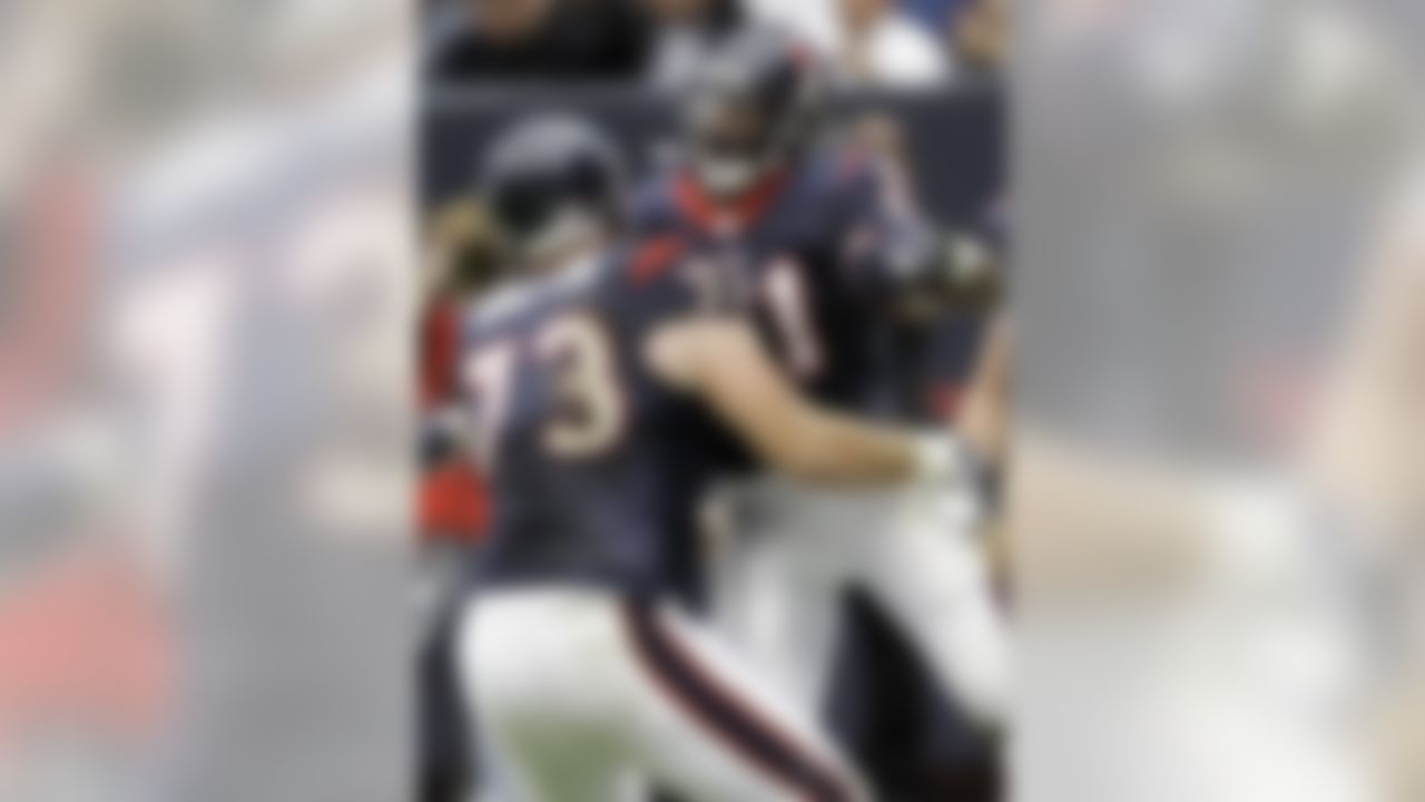 Houston Texans' Eric Winston (73) hugs teammate Ryan Moats (21) after Moats scored a touchdown during the first quarter of an NFL football game Sunday, Dec. 13, 2009, in Houston. (AP Photo/David J. Phillip)