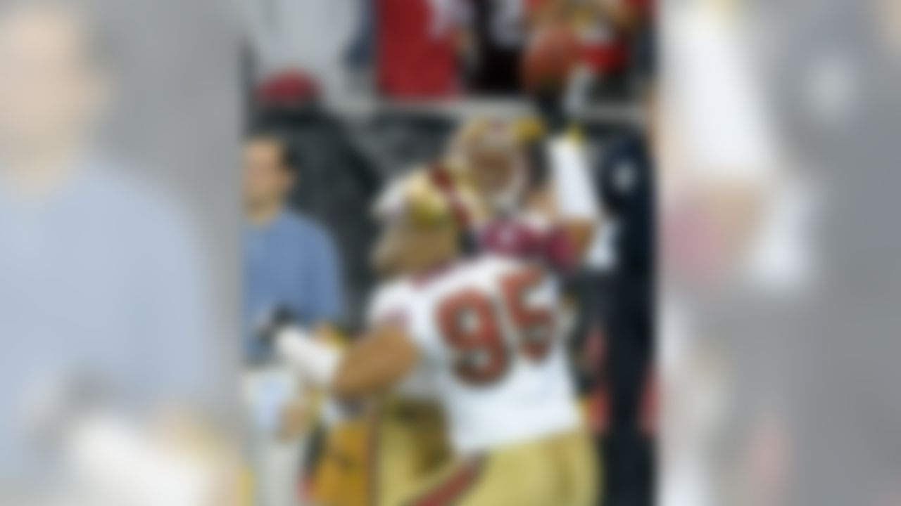 Nov. 25, 2007; Glendale, AZ, USA; San Francisco 49ers linebacker Tully Banta-Cain (95) celebrates after recovering a fumble by Arizona Cardinals quarterback Kurt Warner (not pictured) for a game winning safety in overtime at University of Phoenix Stadium. Mandatory Credit: Mark J. Rebilas-US PRESSWIRE