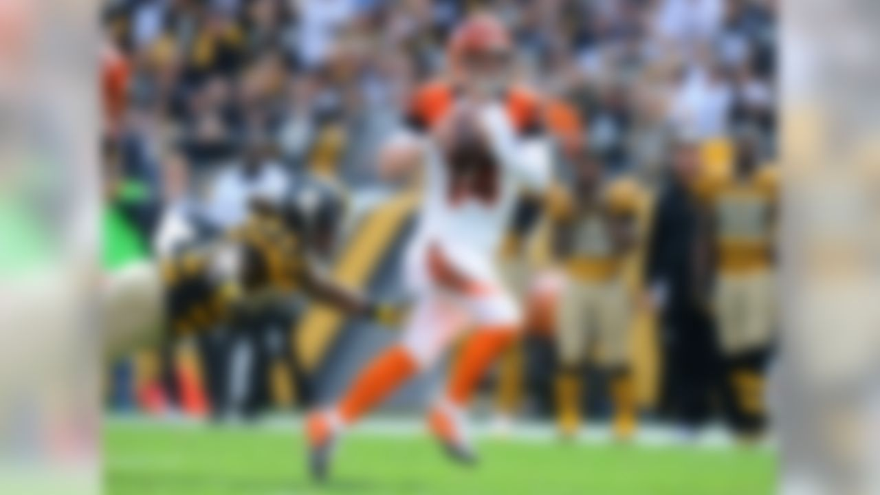 "Dalton is rarely included in the conversation about the NFL's top young quarterbacks, but the fifth-year pro has led his team to four straight playoff appearances and claimed a division title in 2013. Granted, his postseason record (0-4) has created an ""underachiever"" narrative. But thus far this season, Dalton has been debunking that narrative with his spectacular performance, posting a 15:4 touchdown-to-interception ratio and a 107.6 passer rating through seven games. With the Bengals running away with the division crown, Dalton deserves a mention as an MVP candidate."