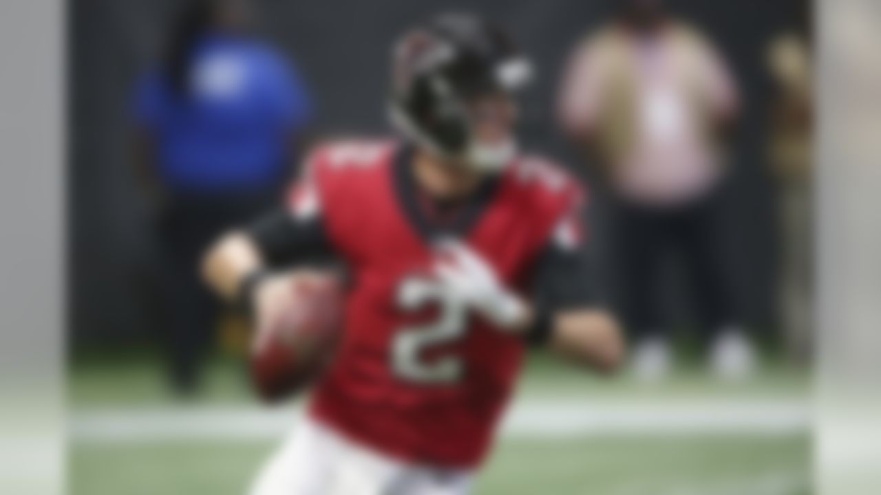 Atlanta Falcons quarterback Matt Ryan (2) works outside the pocket against the Miami Dolphins during the first half of an NFL football game, Sunday, Oct. 15, 2017, in Atlanta. (AP Photo/ John Bazemore))