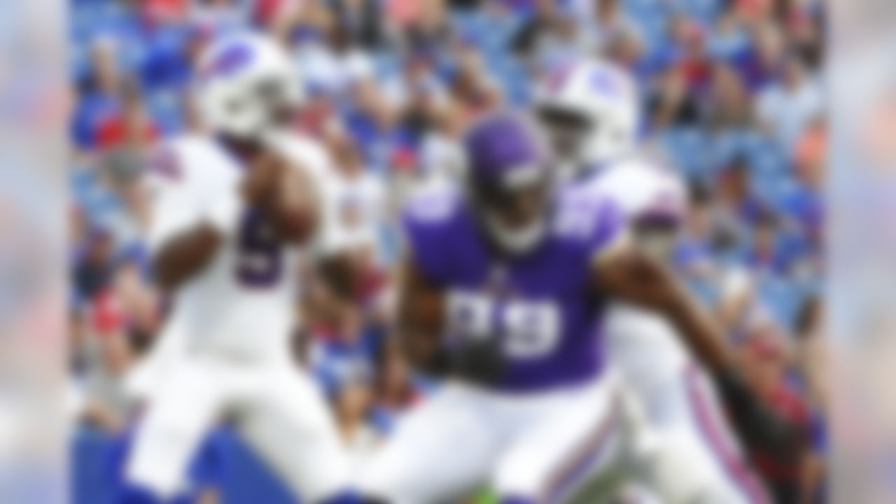 Buffalo Bills quarterback Tyrod Taylor (5) looks to pass as Minnesota Vikings defensive end Danielle Hunter (99) rushes him during the first half of a preseason NFL football game Thursday, Aug. 10, 2017, in Orchard Park, N.Y. (AP Photo/Rich Barnes)