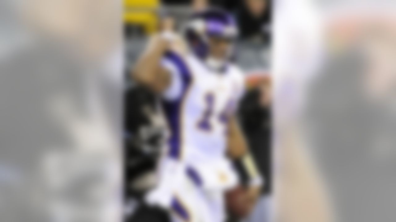 Minnesota Vikings quarterback Joe Webb reacts after scoring a touchdown in the second half of an NFL football game against the Philadelphia Eagles, Tuesday, Dec. 28, 2010, in Philadelphia. (AP Photo/Miles Kennedy)